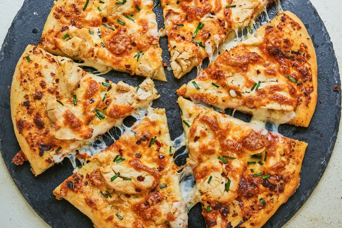 Chicken Alfredo Pizza Is Two Family-Favorite Dishes in One