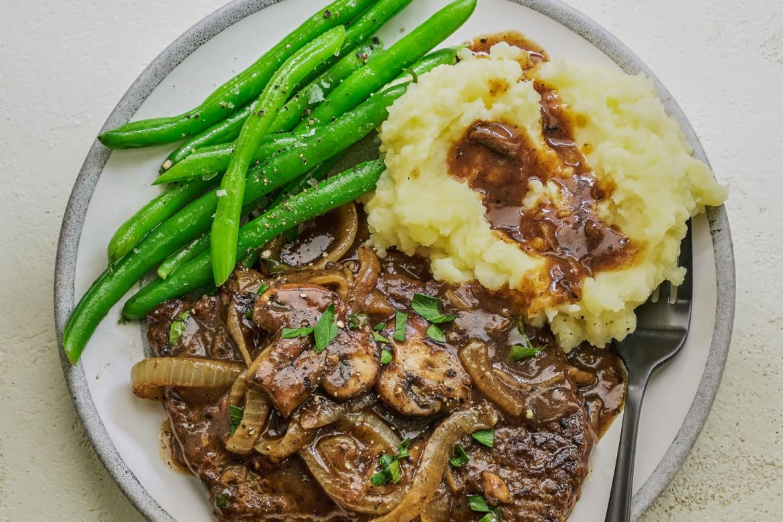 Gravy-Smothered Cube Steak Deserves a Spot on Your Dinner Rotation