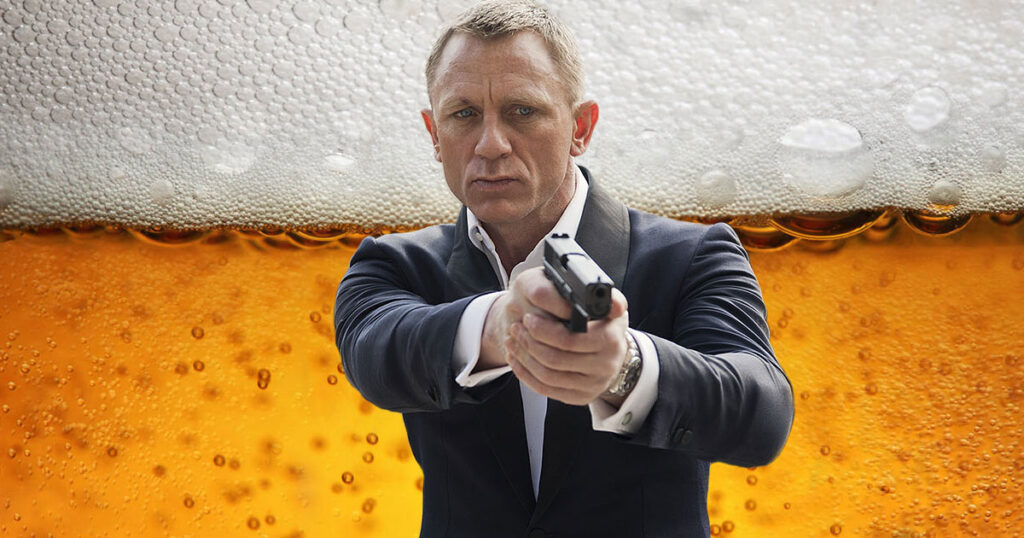 Daniel Craig enjoys a cold one while poking fun at No Time to Die delay in new ad