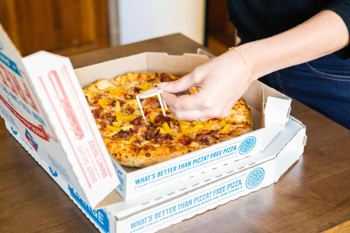 The Brilliant Reason to Save That Plastic Table from Pizza Boxes